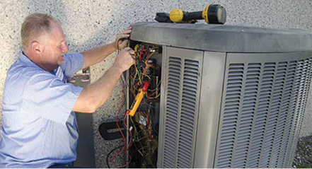 Employee working on an AC unit portraying the staff of commercial HVAC company Steve Chapman's All American Air servicing Jacksonville, FL