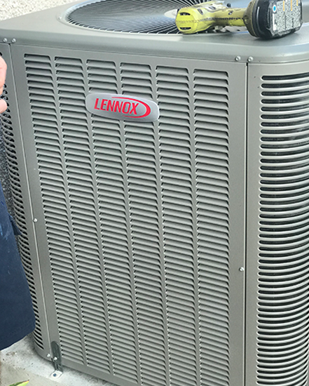 A grey Lennox AC unit representing the appliances worked on by indoor air quality servicer Steve Chapman's All American Air in St. Augustine, FL