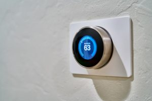 A smart thermostat mounted to a wall